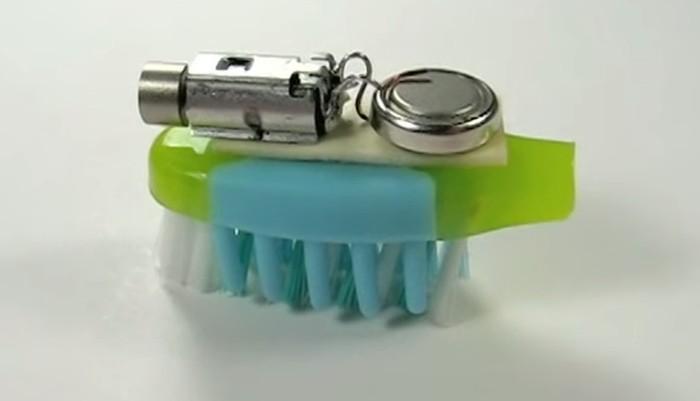 mecanismo sobre cabeca de escova