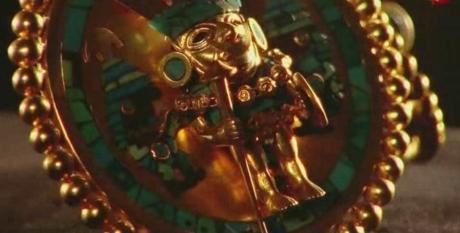 estatueta em ouro
